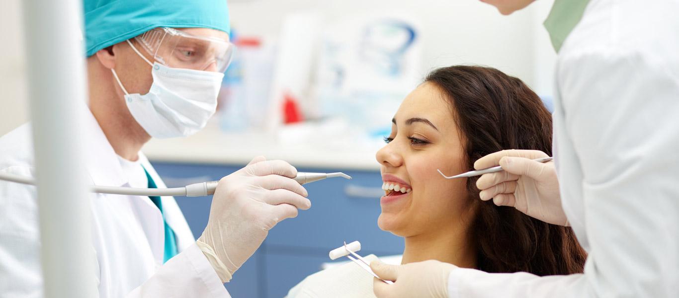 Dentist beginning dental procedure