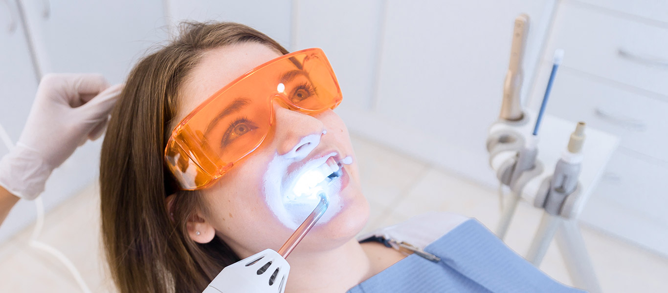 Perfect Dental patient receiving teeth whiting procedure